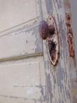 antique-door-and-door-handle-in-farmers-home-long-abandoned_w544_h725